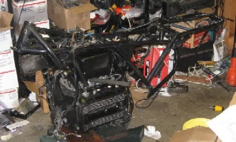 A frame, 2 engines, 8 brake callipers and 4 boxes of unknown parts K75f_022